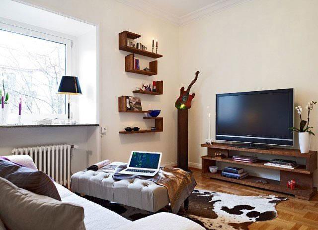 单身公寓温馨5-10万40平米电视背景墙电视柜效果图