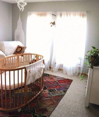 实木圆形婴儿床图片