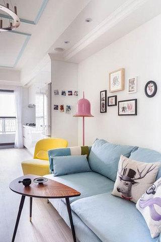 白色墙面蓝色沙发客厅