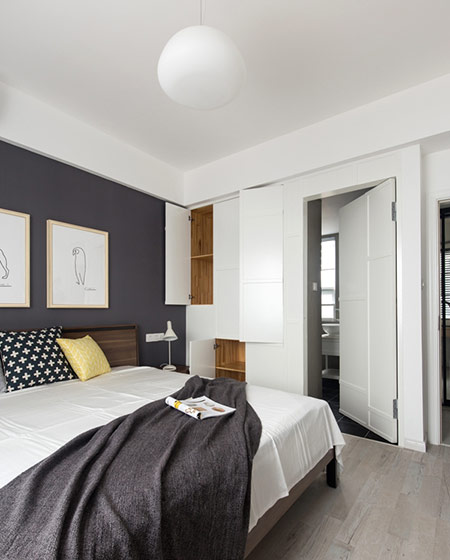 100平北欧风三居卧室衣柜设计