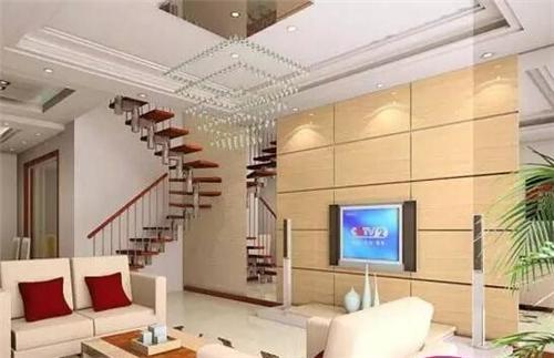 实木的电视背景墙在霓虹的照射下感觉十分的大气,复式客厅吊顶也选用