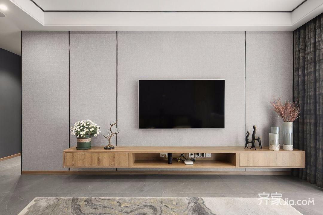 电视背景墙用灰色墙布和线条划分,电视柜中部留空,内藏插座,方便日常