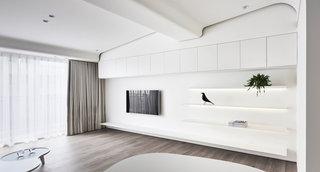 极简风白色公寓电视背景墙装修效果图