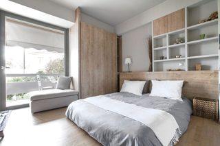 白灰色现代公寓卧室装修效果图