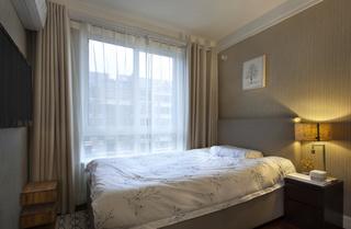 灰色调现代简约三居卧室装修效果图